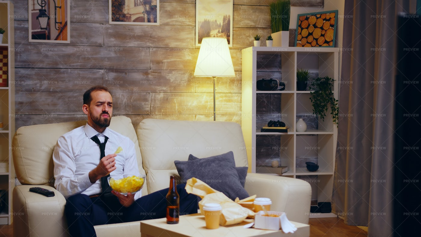 Eating Chips After Work: Stock Photos