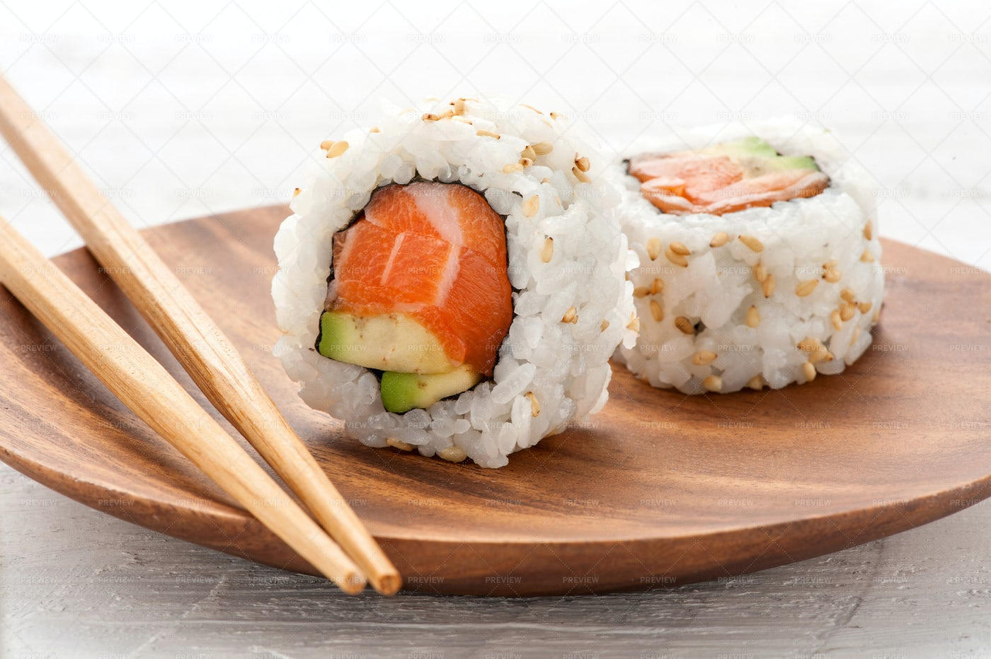 Two Fresh Salmon And Avocado Sushi: Stock Photos