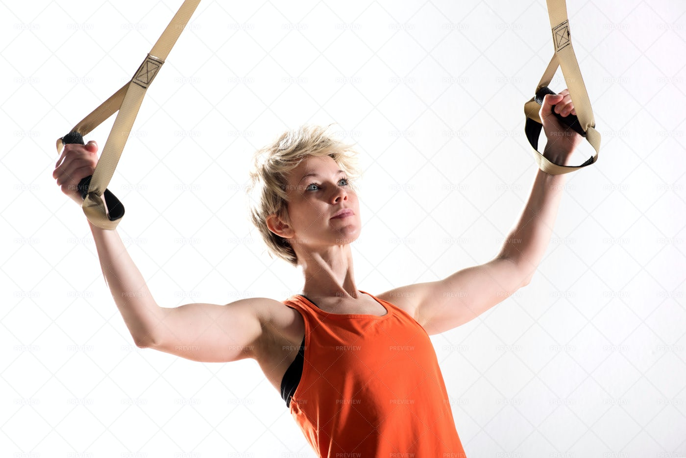 Strong Woman Pulling Fitness Cords: Stock Photos