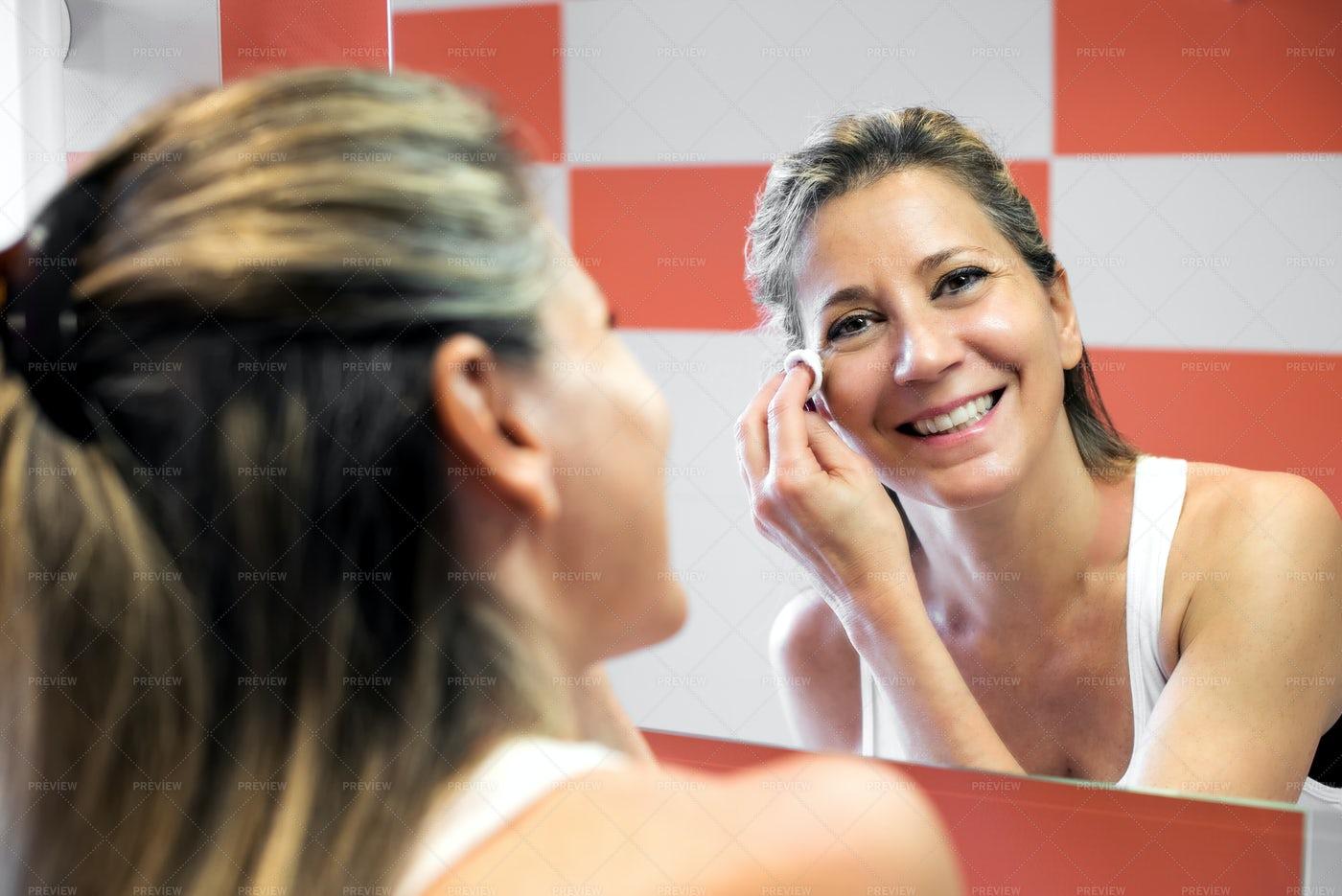 Woman Removing Her Makeup: Stock Photos