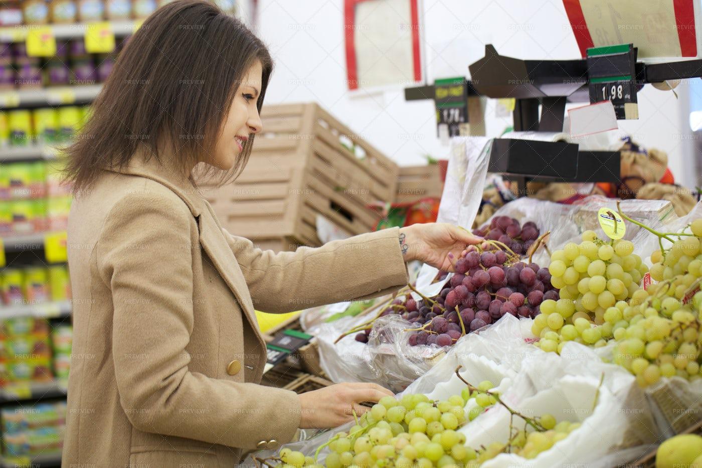 Woman Buying Grapes: Stock Photos