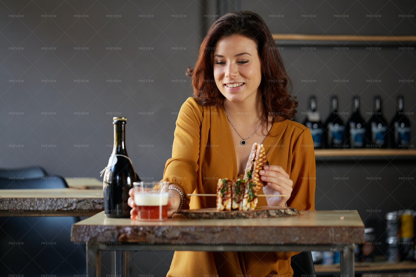 Woman Drinking And Eating: Stock Photos