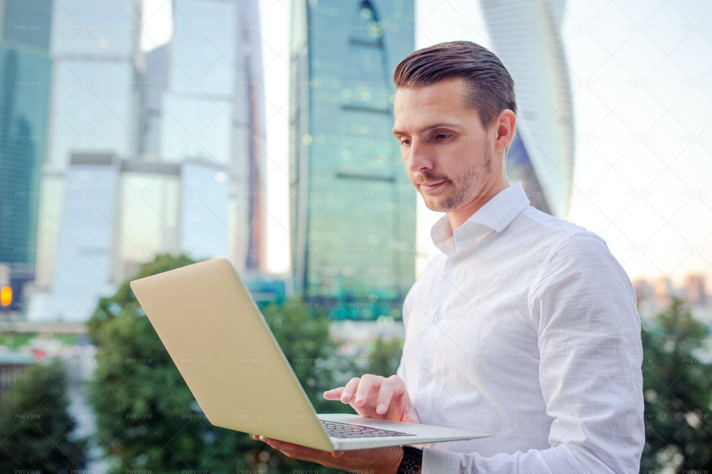 Executive Man Holding Laptop: Stock Photos