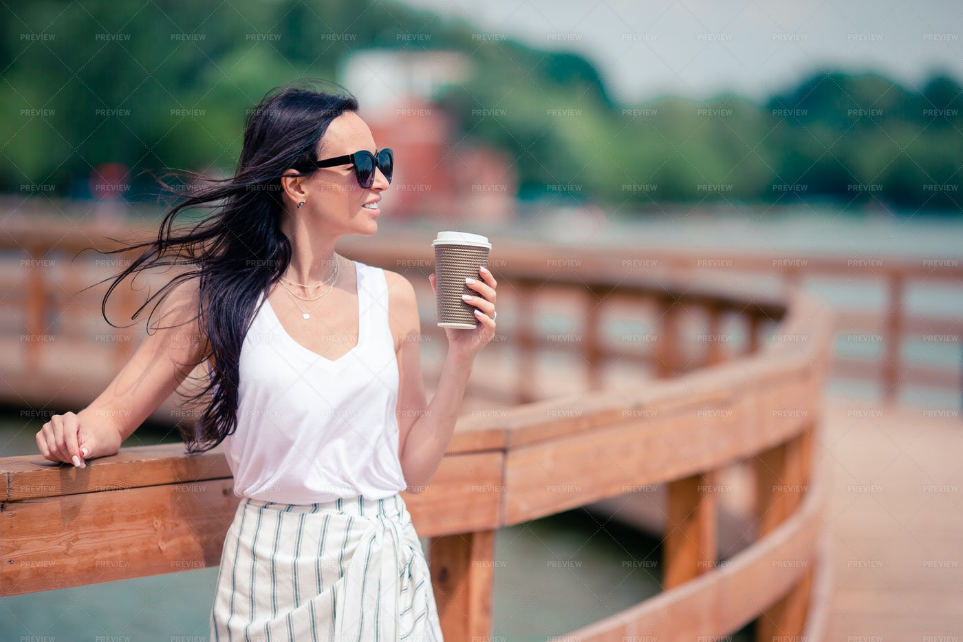 Drinking Coffee On A Bridge: Stock Photos