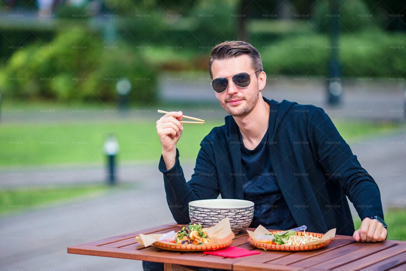 Young Man Eating: Stock Photos