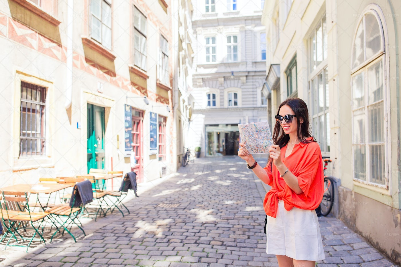 Holding A Map In Vienna: Stock Photos
