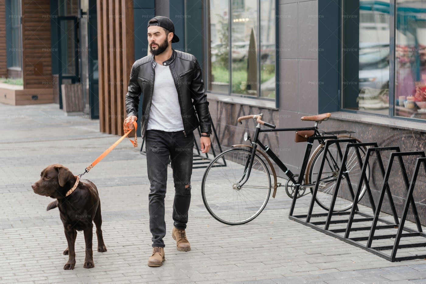 Handsome Guy In Casualwear Holding...: Stock Photos