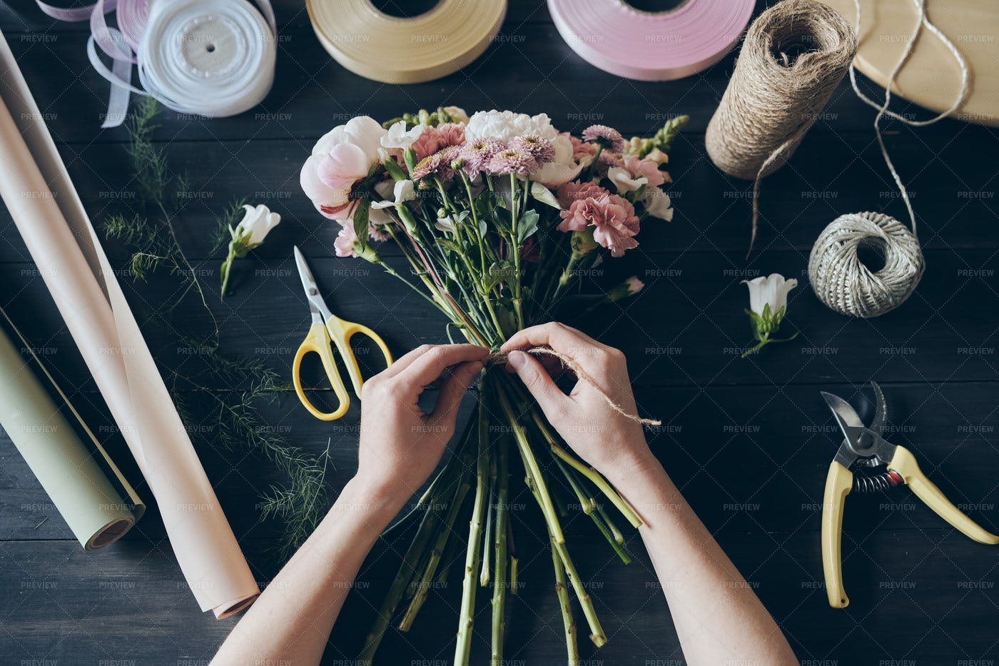 Tying Flowers With String: Stock Photos