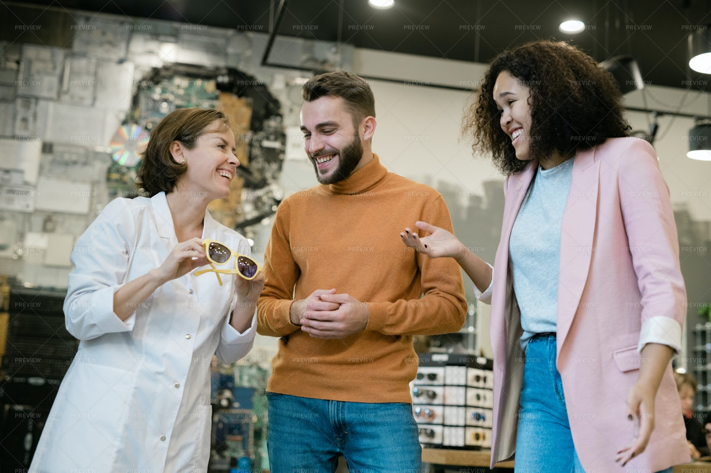 Shop Assistant Helping Young...: Stock Photos