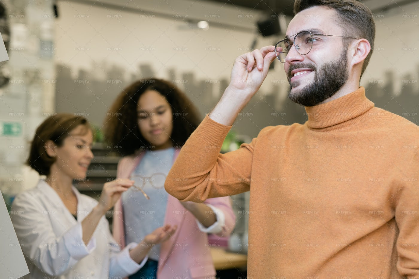 Happy Guy Trying On Pair Of...: Stock Photos