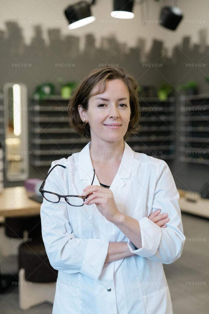 Pretty Young Clinician Holding Pair...: Stock Photos