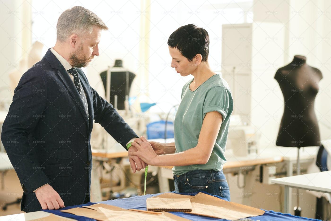 Measuring Wrist Of Client: Stock Photos