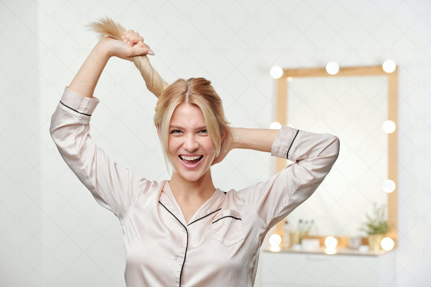 Pretty Joyful Girl Holding Ponytail...: Stock Photos