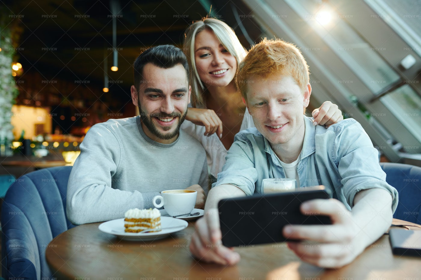 Two Happy Guys And Pretty Blonde...: Stock Photos