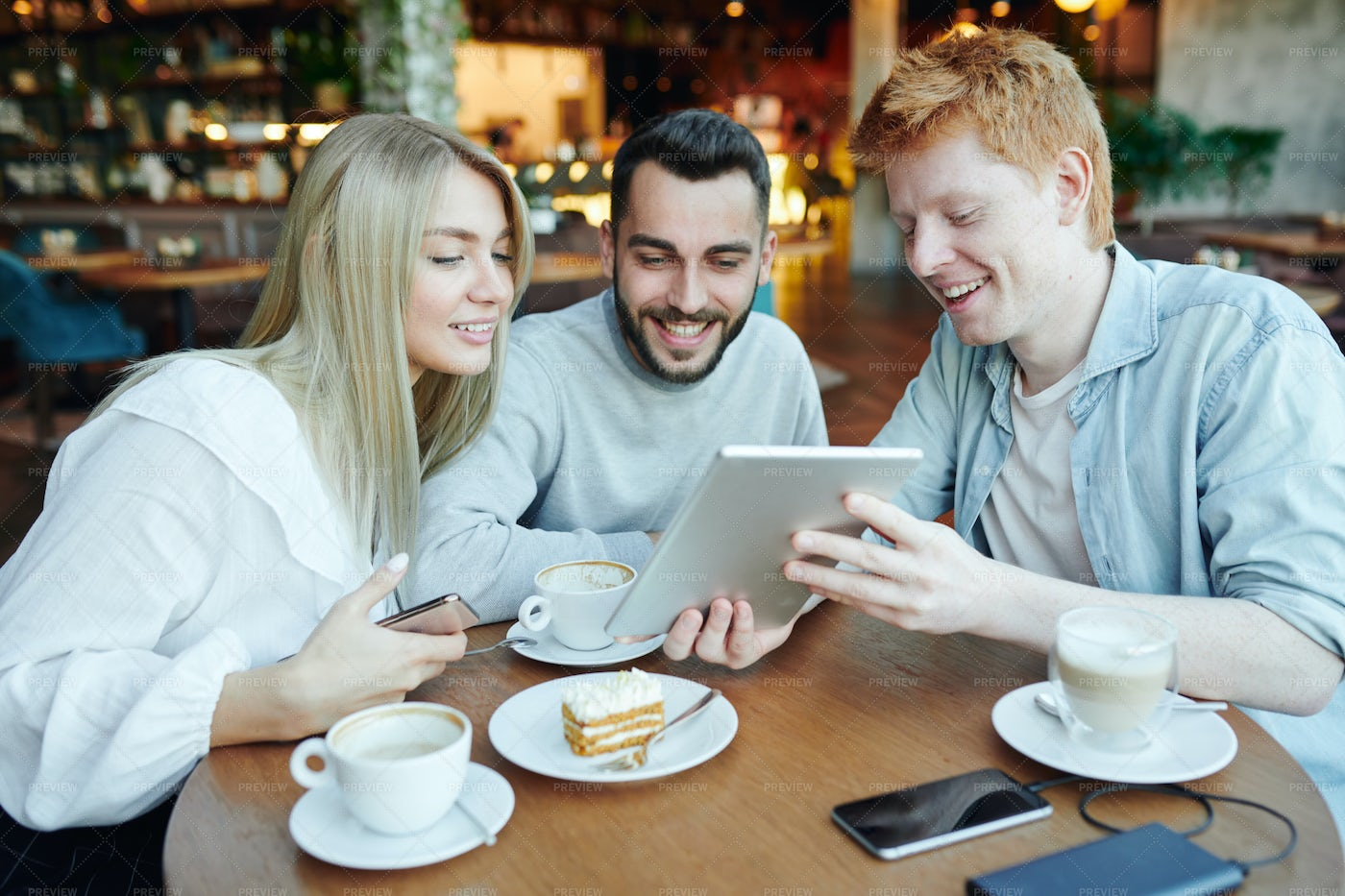 Cheerful Man Showing His Friends...: Stock Photos