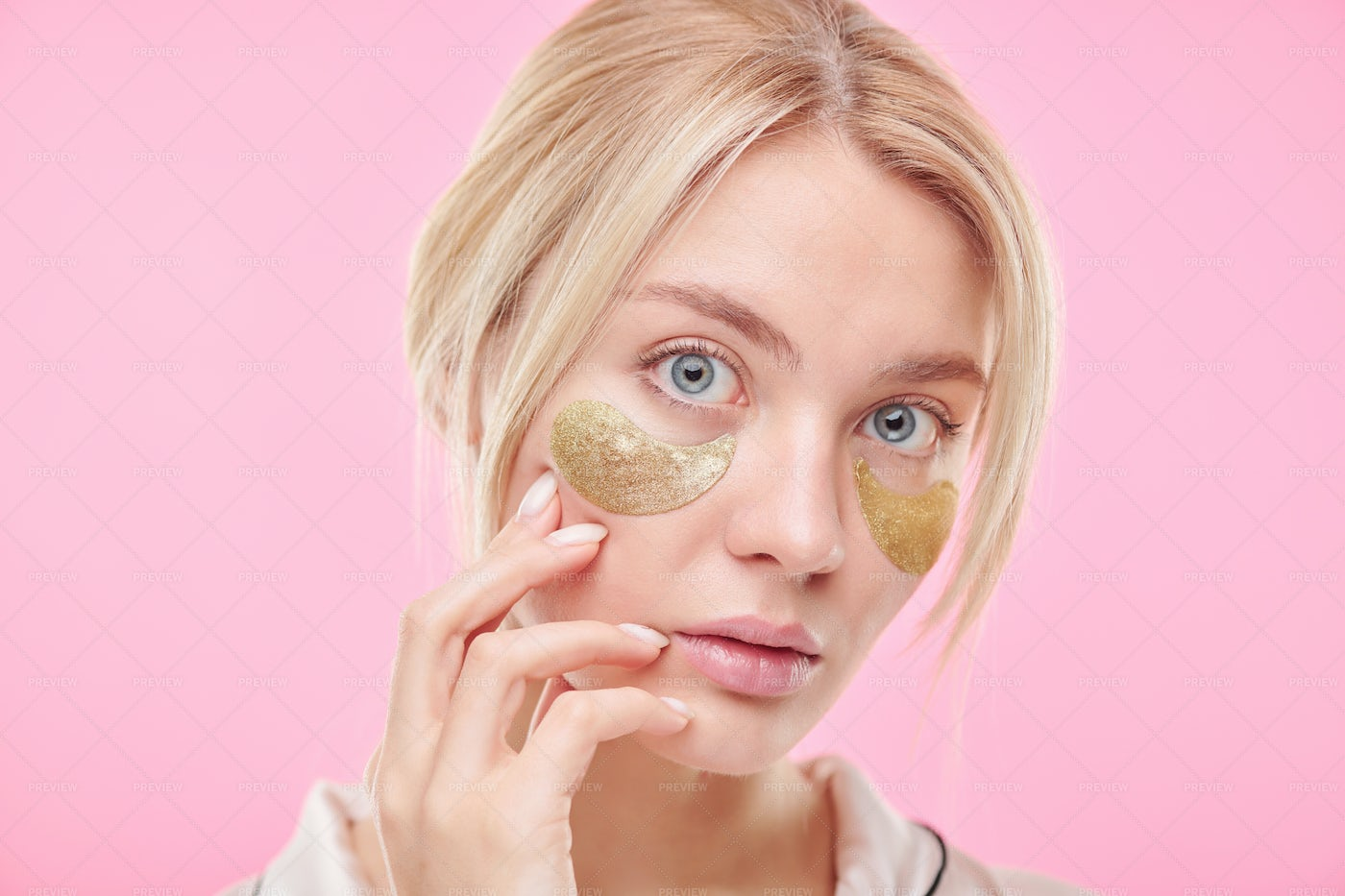 Attractive Blond Woman Touching Her...: Stock Photos