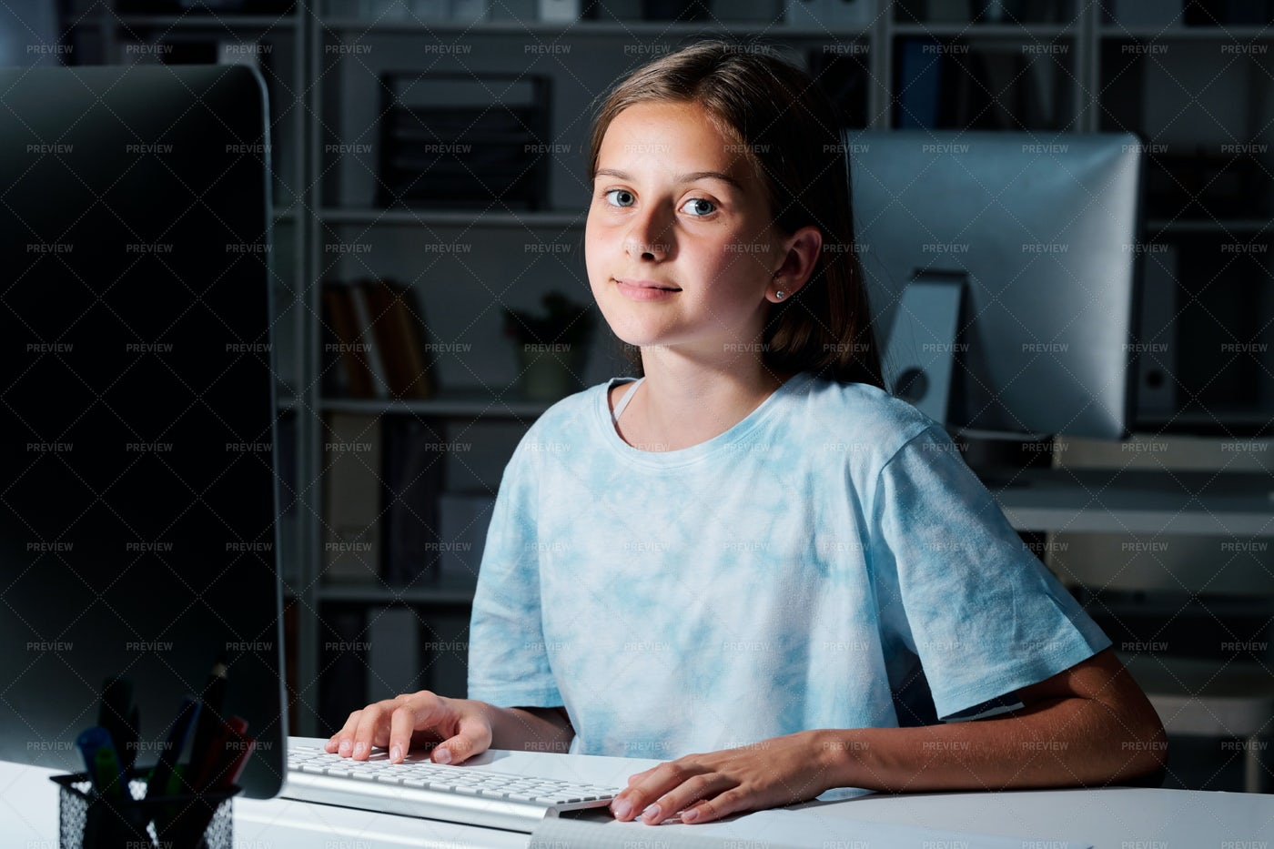 Cute Student Looking At You While...: Stock Photos