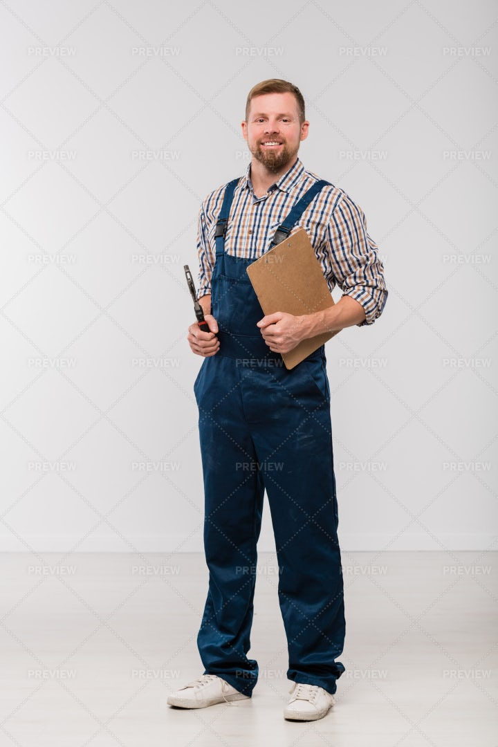 Happy Young Mechanic In Coveralls...: Stock Photos