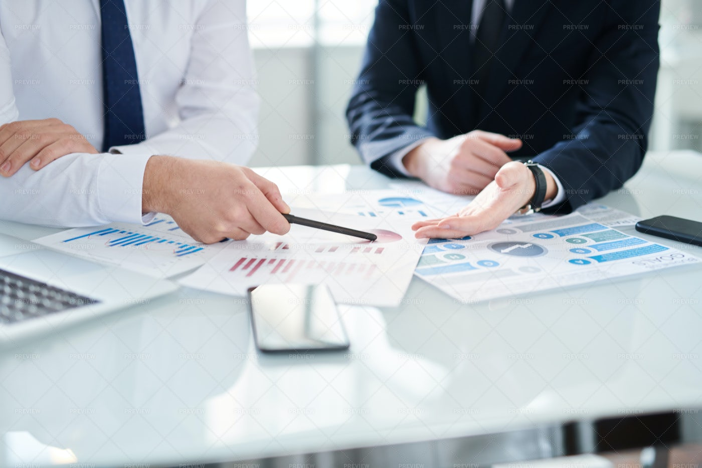 Discussing Financial Papers: Stock Photos