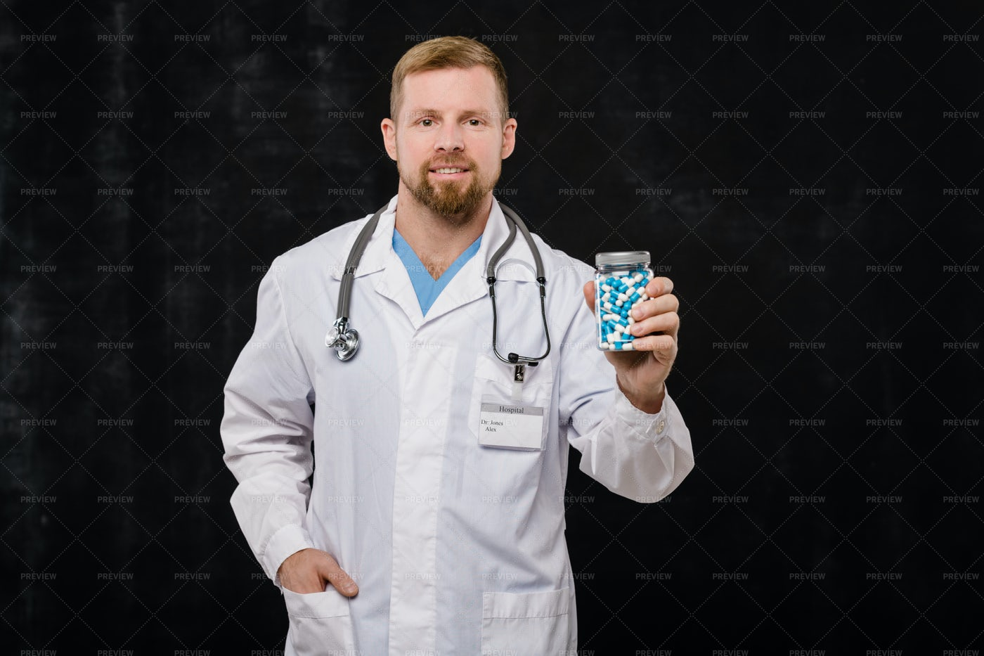 Happy Young Bearded Doctor In...: Stock Photos