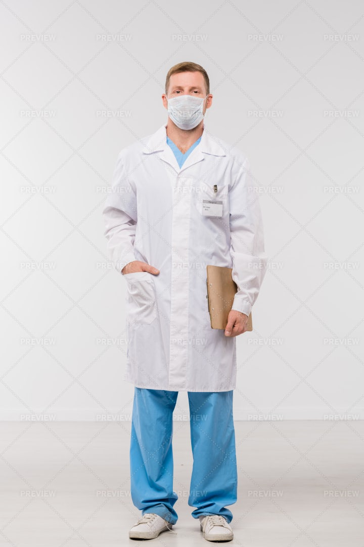 Young Clinician In Whitecoat,...: Stock Photos