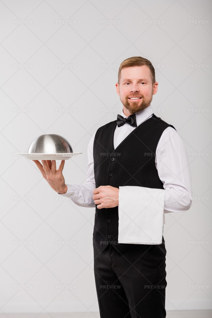 Happy Young Waiter In Black...: Stock Photos