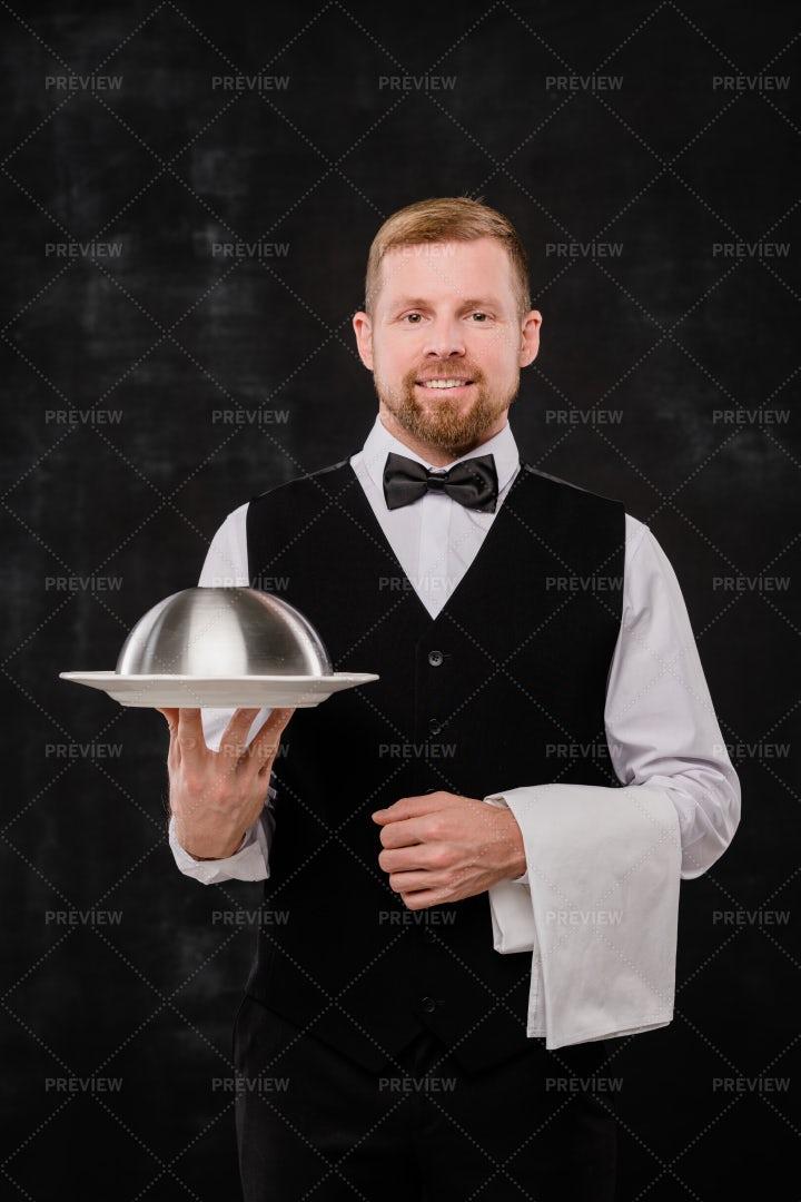 Happy Young Elegant Waiter Holding...: Stock Photos