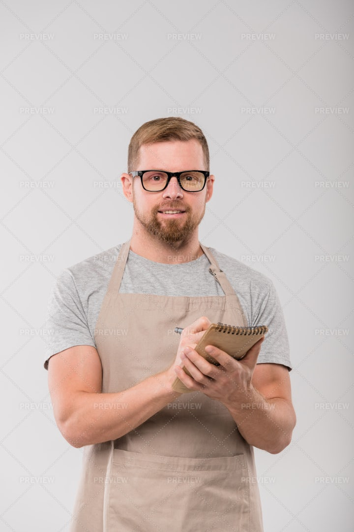 Young Handsome Waiter In Apron And...: Stock Photos