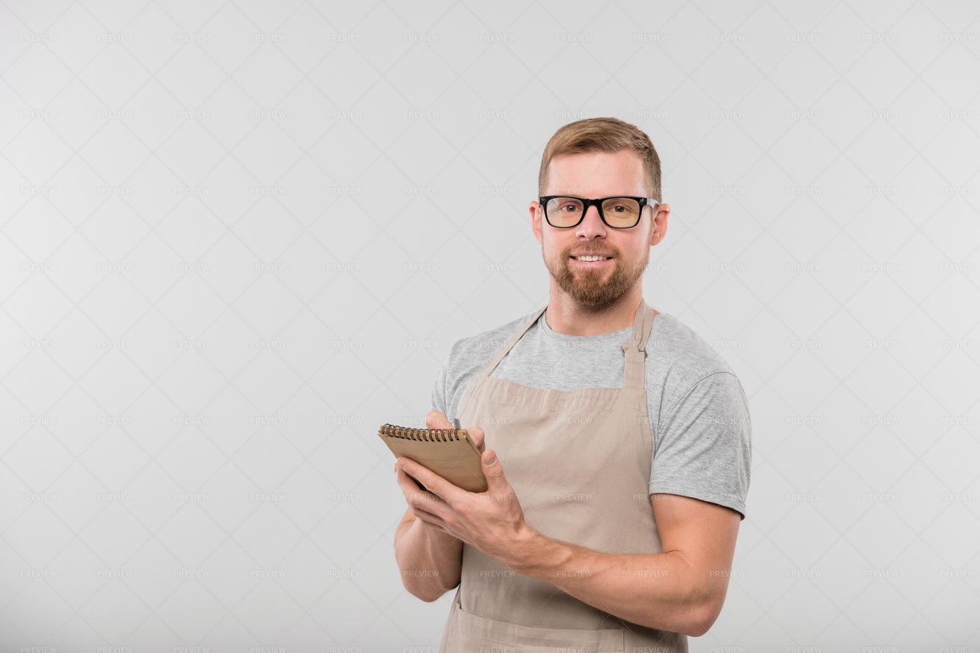 Happy Young Bearded Waiter Writing...: Stock Photos