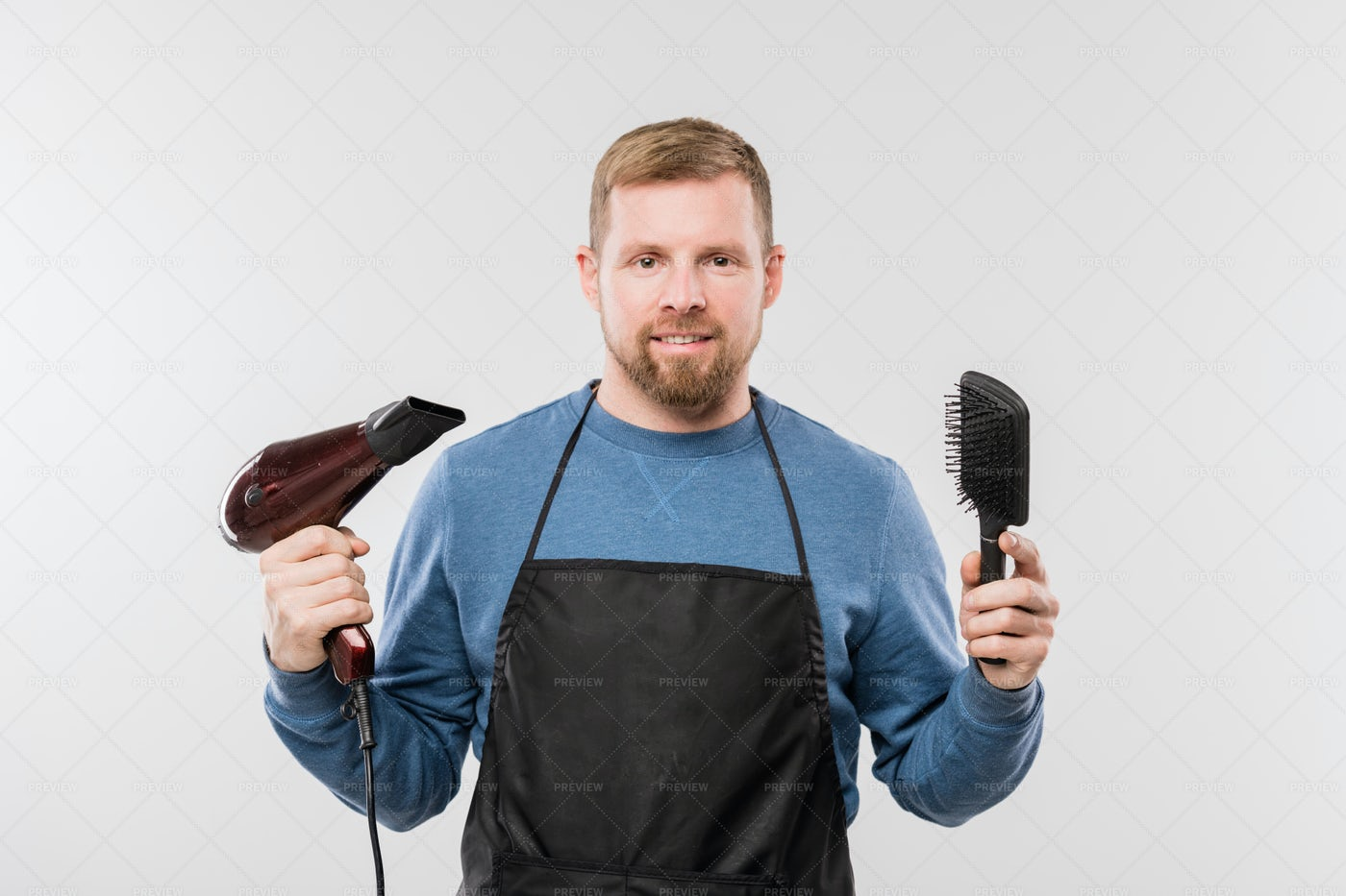 Happy Young Bearded Hairdresser In...: Stock Photos