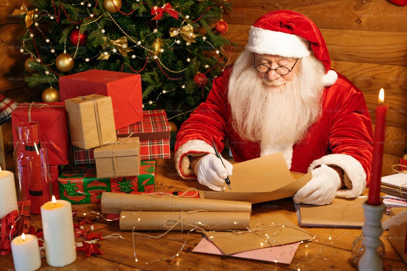 Santa With Long White Beard Writing...: Stock Photos