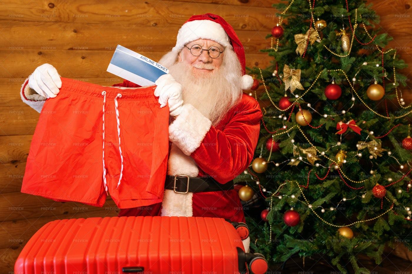 Happy Santa Showing One Of...: Stock Photos