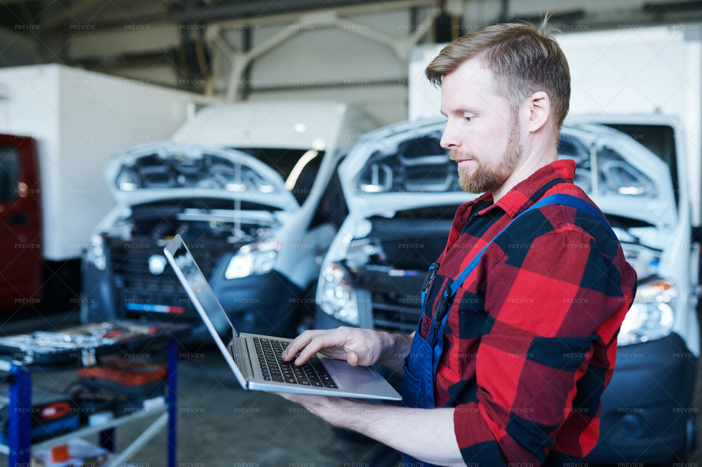 Mechanic Browsing In The Net: Stock Photos