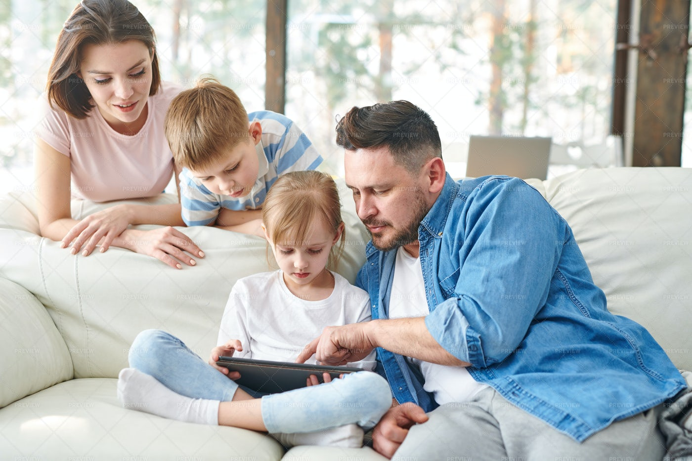 Family On Sofa: Stock Photos