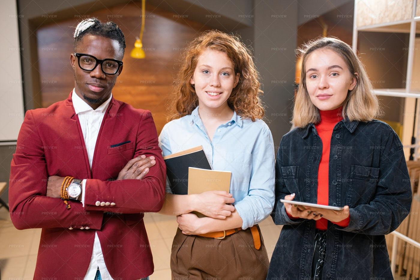 Three Young Intercultural College...: Stock Photos