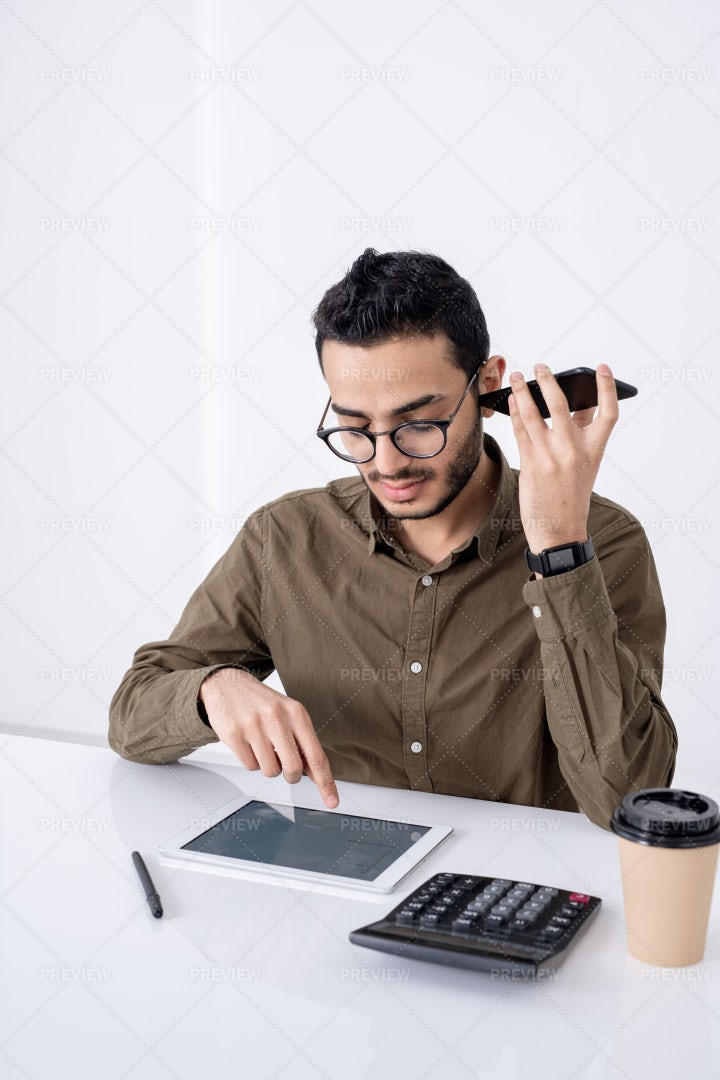 Busy Young Male Accountant With...: Stock Photos