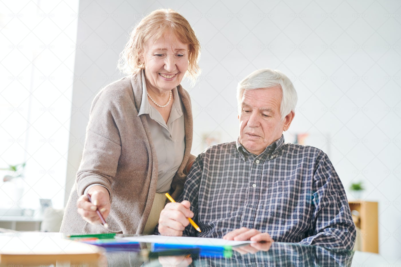 Discussing What To Draw: Stock Photos