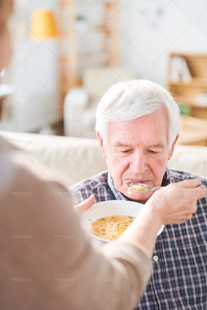 Feeding Disable Man With Soup: Stock Photos
