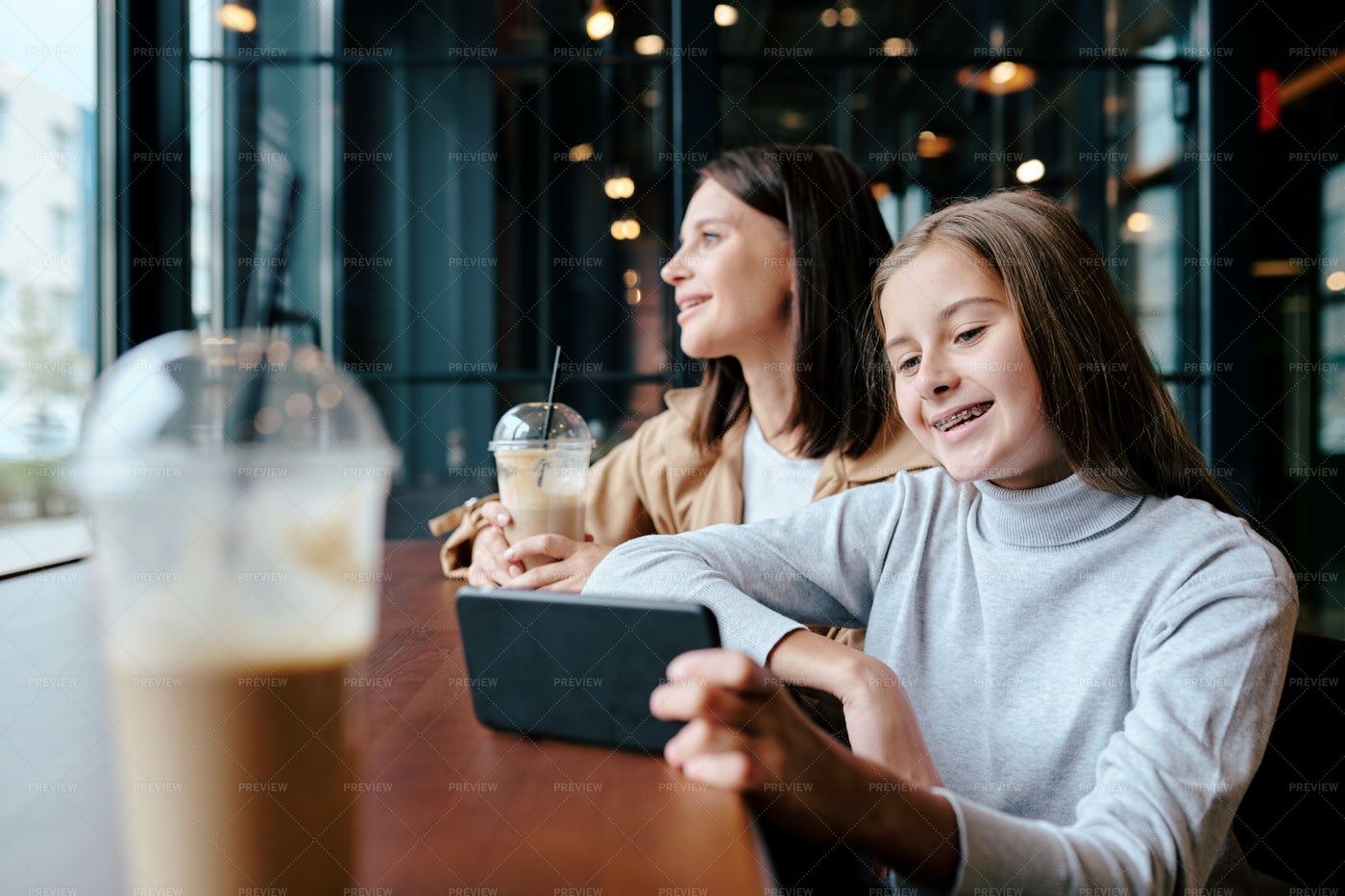 Cheerful Girl Watching Funny Video...: Stock Photos