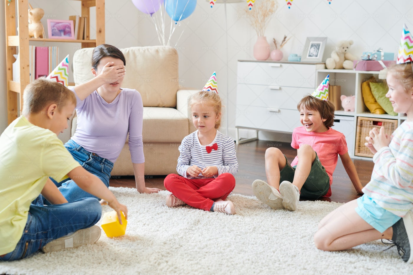 Woman Playing With Kids: Stock Photos