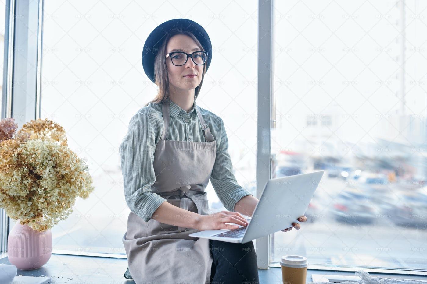 Florist With Laptop: Stock Photos