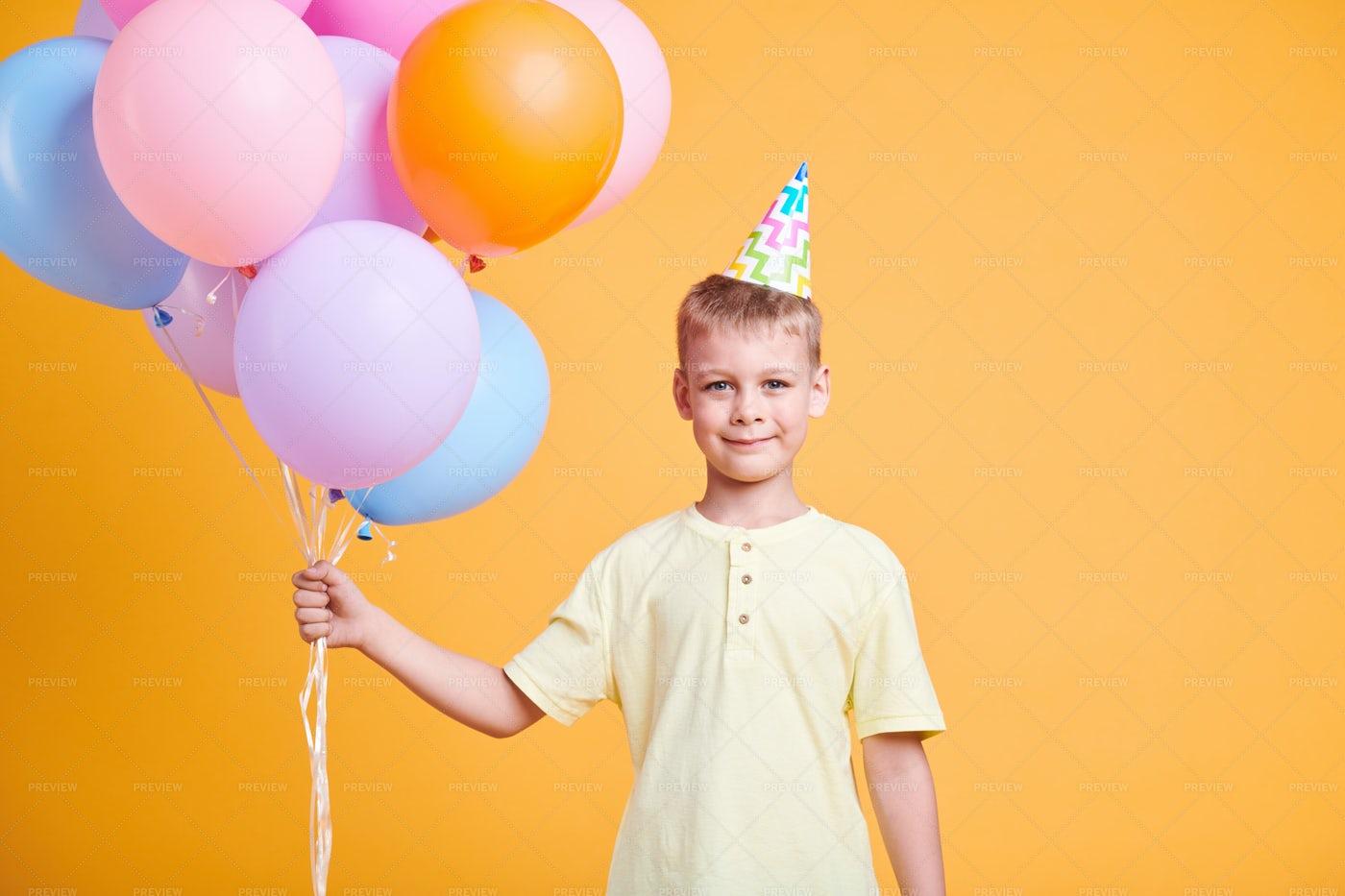 Cute Boy With Balloons: Stock Photos