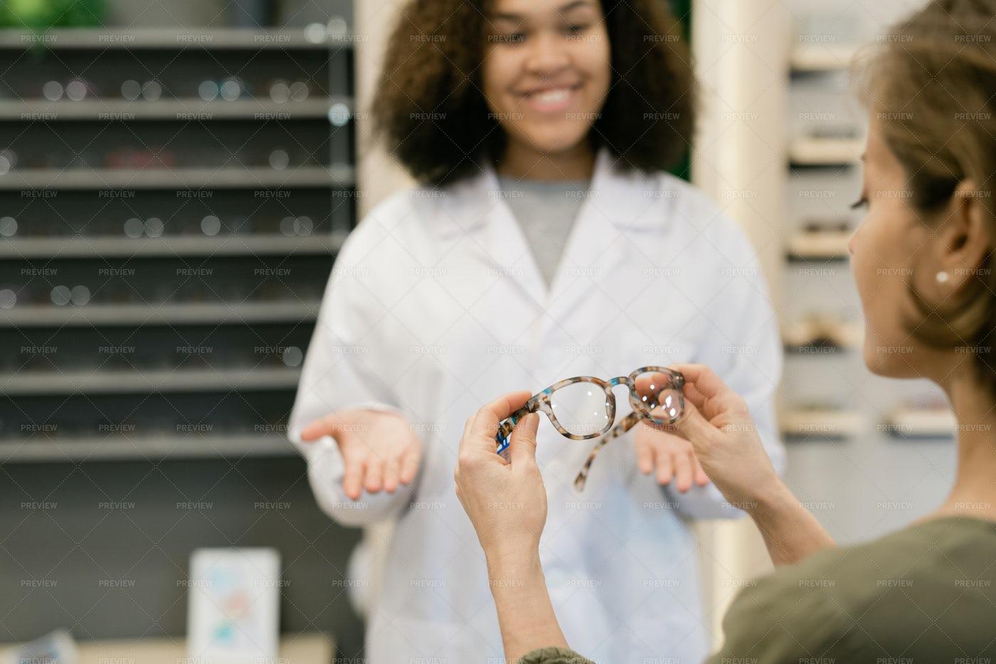 Woman Holding Stylish Eyeglasses...: Stock Photos
