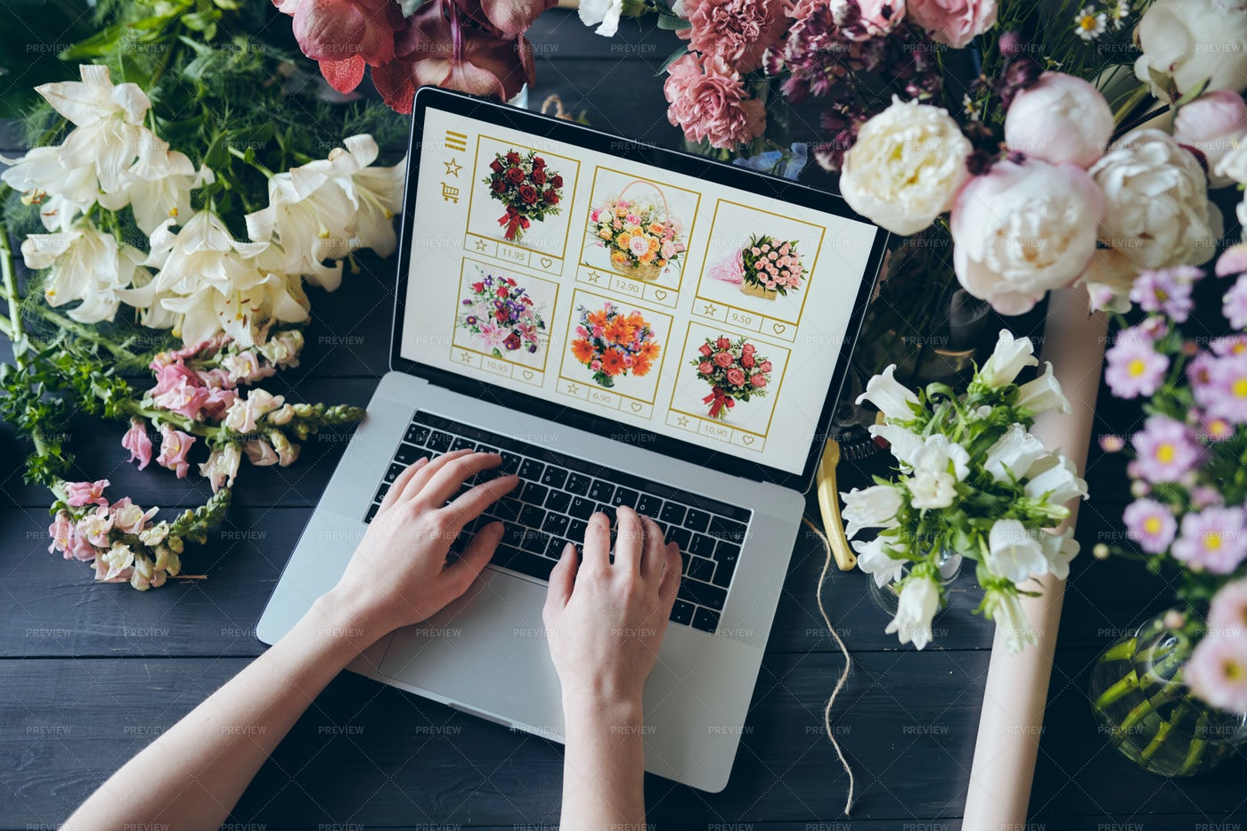 Adding Flowers To Cart On Web...: Stock Photos