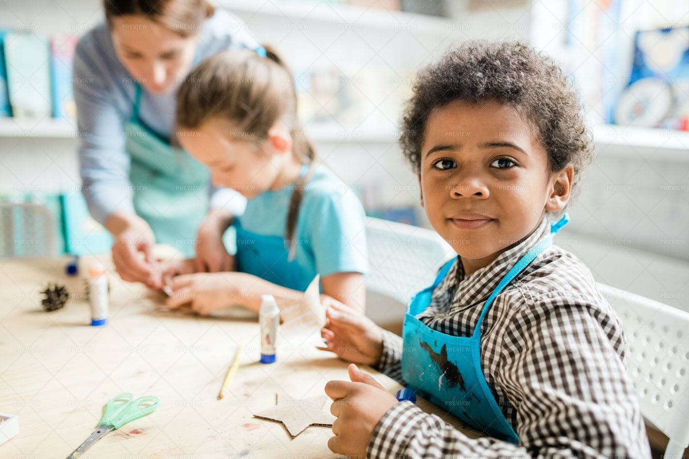 Cute Schoolboy In Blue Apron...: Stock Photos