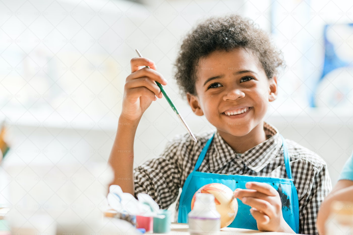 Cheerful Schoolboy With Paintbrush...: Stock Photos