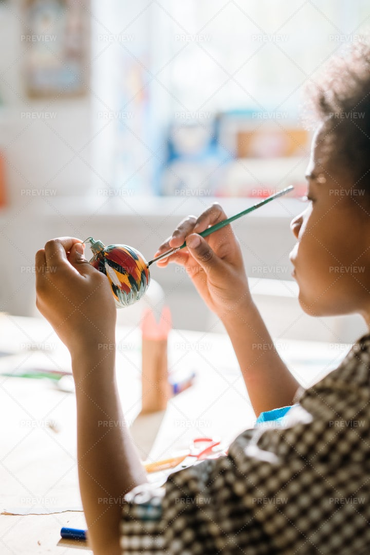 Diligent African Pupil Painting...: Stock Photos
