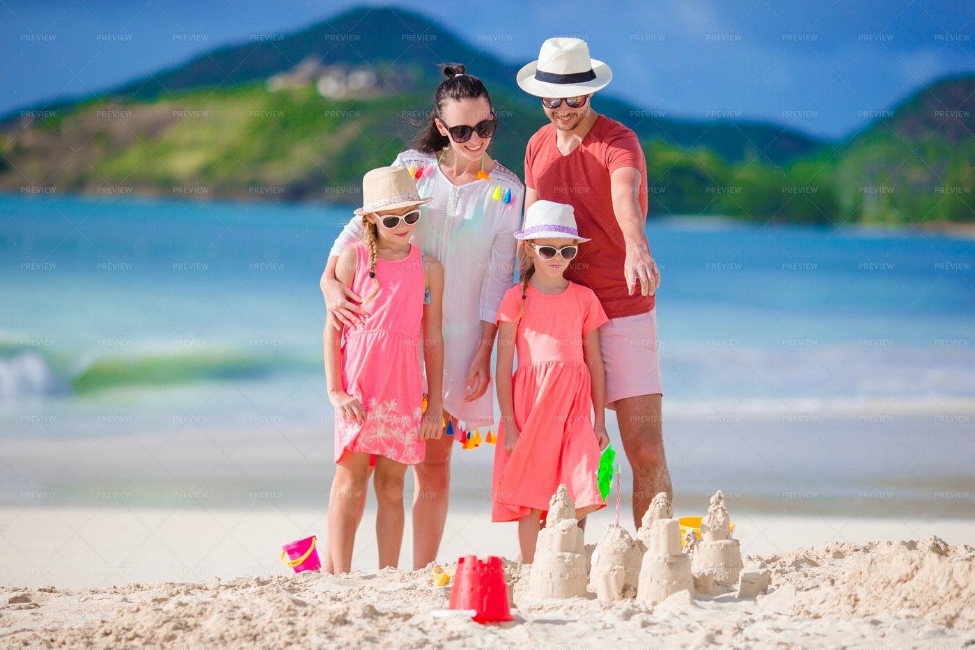 Family Making Sand Castles: Stock Photos