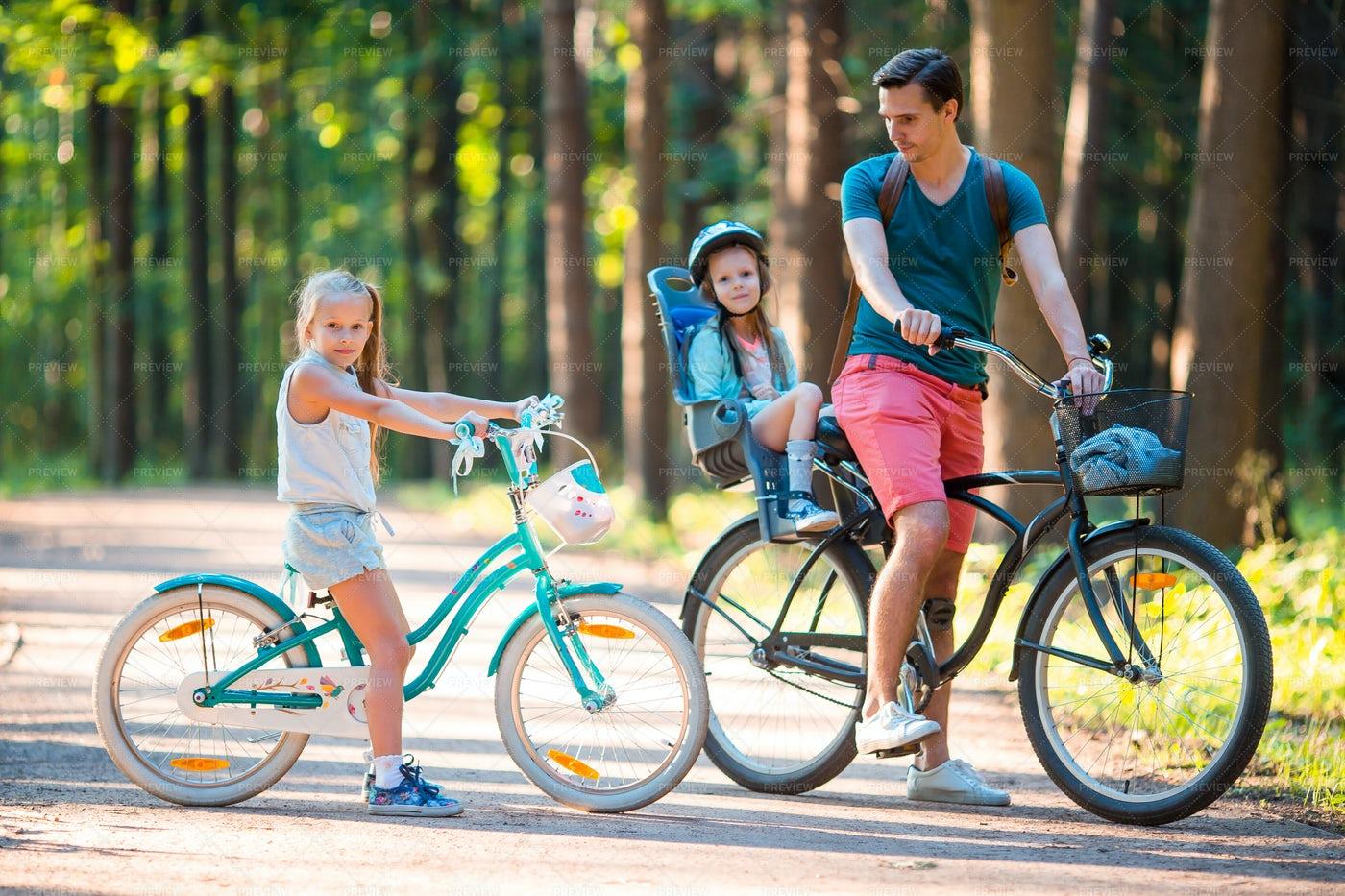 Happy Family Biking: Stock Photos