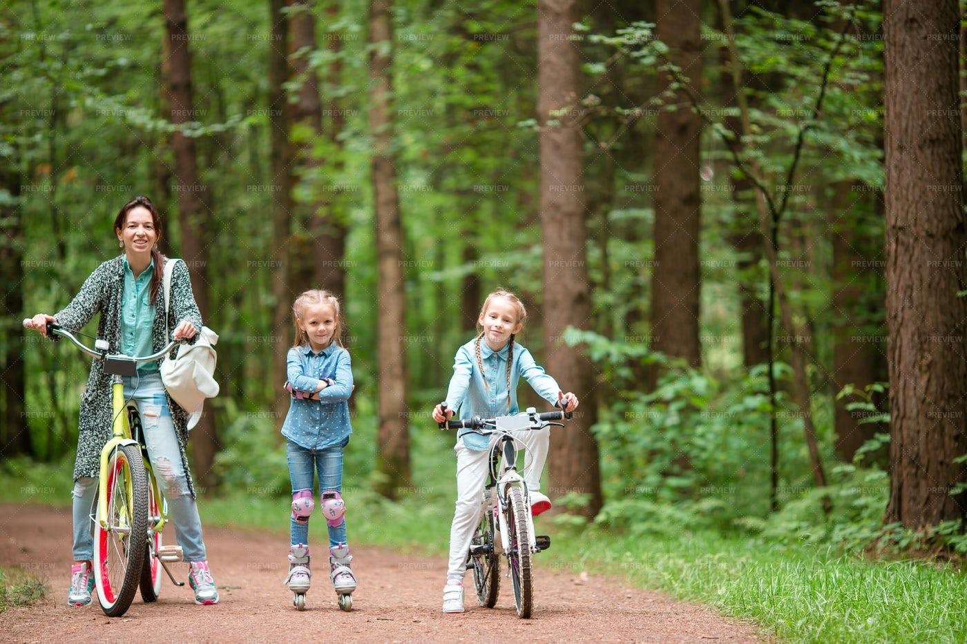 Family Riding Bicycle: Stock Photos